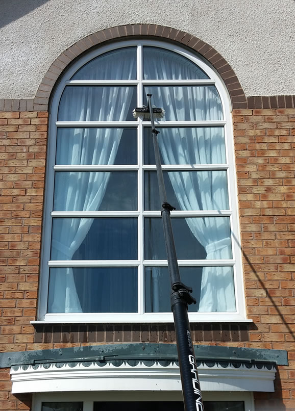 Pure water reach and wash pole system window cleaning for shops in Kettering and Corby